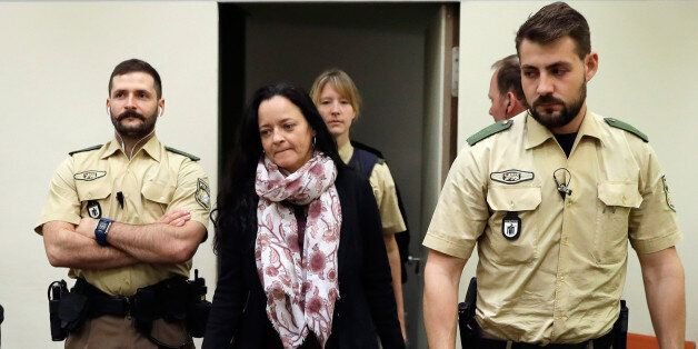 Defendant Beate Zschaepe (2nd L) arrives at a courtroom on September 12, 2017 in Munich, southern Germany.German...