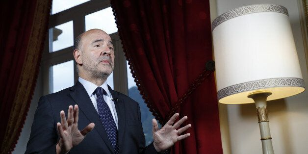 Pierre Moscovici, economic commissioner for the European Union (EU), gestures while speaking during a...