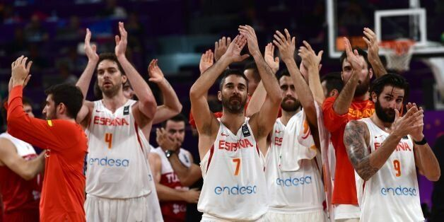 Spain's players celebrate after winning against Turkey at the end of the FIBA Eurobasket 2017 men's round...