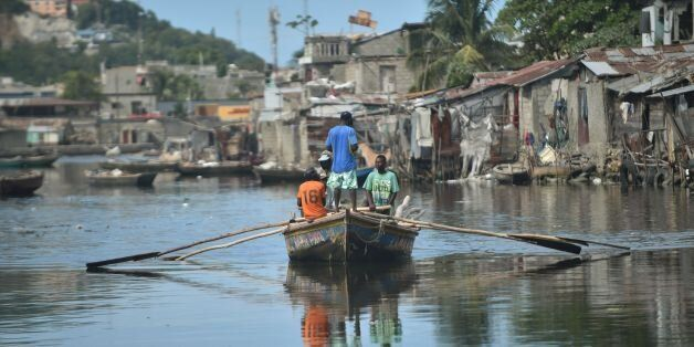 Men sail on Mapou Riverin Shadaa neighborhood, in Cap-Haitien, in the north of Haiti, 240 km from Port-au-Prince,...