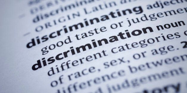 Discrimination: Dictionary Close-up. Selective focus and Canon EOS 5D Mark II with MP-E 65mm macro