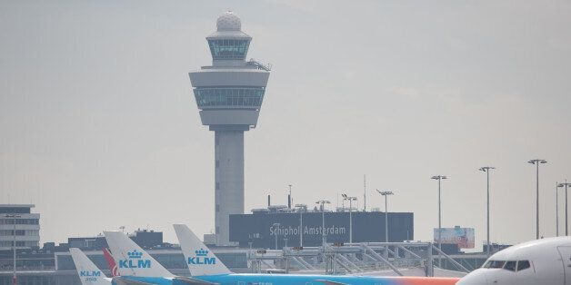 Passenger aircraft operated by KLM, the Dutch arm of Air France-KLM Group, stand at boarding gates at...