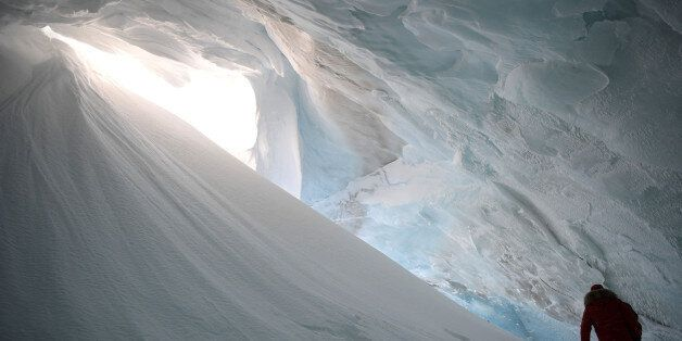 Russian President Vladimir Putin visits the cave of Arctic Pilots Glacier in Alexandra Land in remote...
