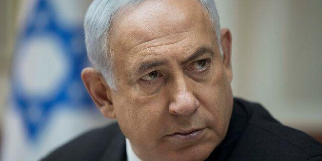 Israeli Prime Minister Benjamin Netanyahu attends a weekly cabinet meeting in Jerusalem, September 3,...