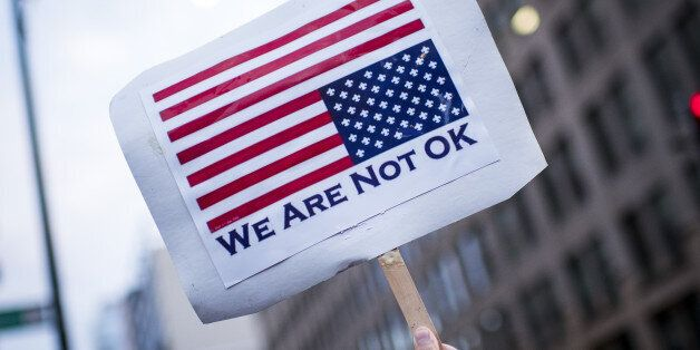 A placard is displayed in front of the U.S. Immigration and Customs Enforcement (ICE) headquarters at...