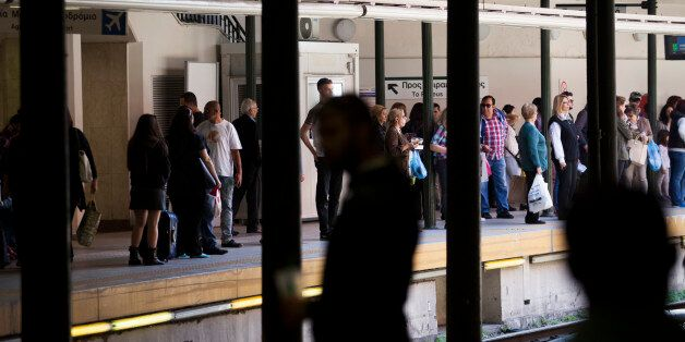 ATHENS, GREECE - APRIL 9: People wait for the metro, or subway, on April 9, 2016 in Athens, Greece. Athens...