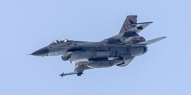 An Israeli F-16 fighter jet is seen as Israeli soldiers take part in a training session during the 'Novel...