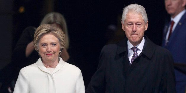 Former president Bill Clinton (R) and former Democratic presidential candidate Hillary Clinton arrive at inauguration ceremonies swearing in Donald Trump as the 45th president of the United States on the West front of the U.S. Capitol in Washington, U.S., January 20, 2017. REUTERS/Carlos Barria
