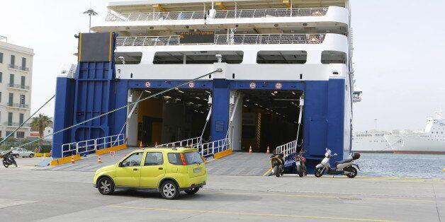 ATHENS, ATTICA, GREECE - 2015/01/31: The M/F Blue Star Patmos ferry lies on the pier of Piraeus. The...