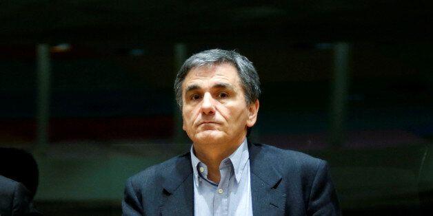 Greek Finance Minister Euclid Tsakalotos attends a eurozone finance ministers meeting in Brussels, Belgium...