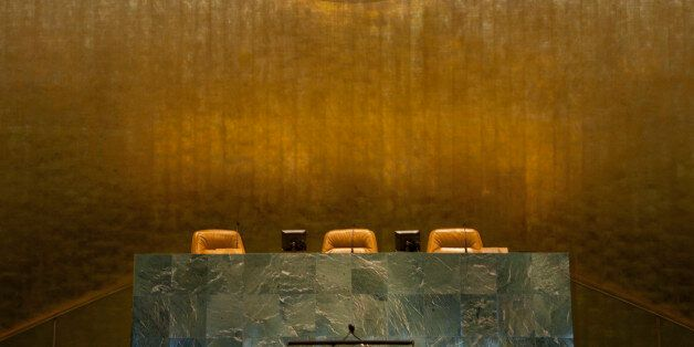 Speakers seats under Emblem of the United Nations in the General Assembly, United Nations Building, New...