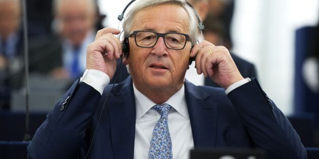 European Commission President Jean-Claude Juncker adjusts headphones before delivers his State of the...