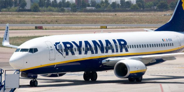'Valencia, Spain - June 24, 2010: A Ryanair aircraft taxis to the gate at the Valencia airport. Ryanair...