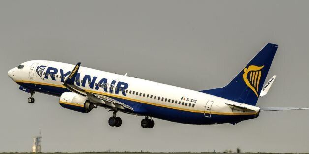 A Ryanair aircraft takes off from Lille Airport in Lesquin on August 25, 2017. / AFP PHOTO / PHILIPPE...