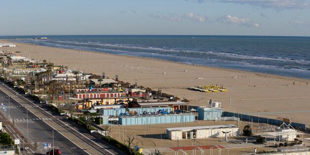 The beach is seen on the coast of Rimini April 16, 2014. Italy's beaches are a family affair - and that's...