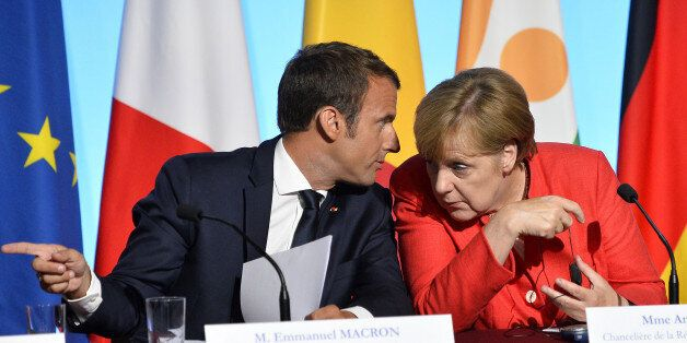 PARIS, FRANCE - AUGUST 28: French President Emmanuel Macron and German Chancelor Angela Merkel react...