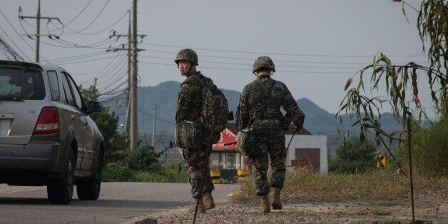 South Korean soldiers walk to a checkpoint at the Demilitarized zone (DMZ) separating North and South...