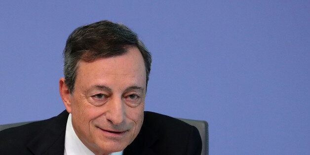 Mario Draghi, president of the European Central Bank (ECB), speaks during a news conference following...