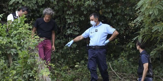 French gendarmes search for evidence around the garden of a man near Pont-de-Beauvoisin, eastern france,...