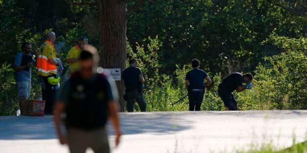 Spanish policemen check the site where Moroccan suspect Younes Abouyaaqoub was shot on August 21, 2017...