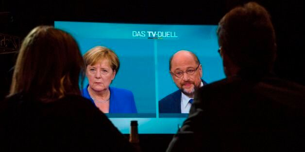 Journalists watch a televised debate between German Chancellor and leader of the conservative Christian...