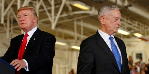 U.S. President Donald Trump (L) is introduced by Defense Secretary James Mattis (R) during the commissioning...