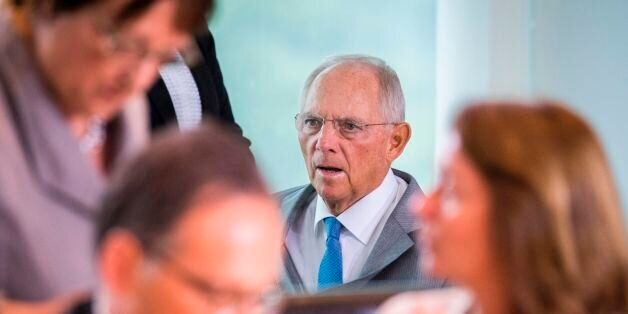 German finance minister Wolfgang Schaeuble arrives for the weekly cabinet meeting at the Chancellery...