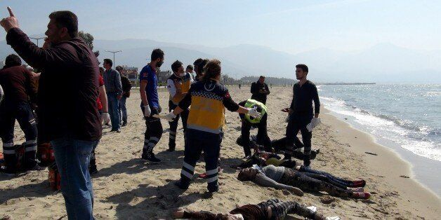 TOPSHOT - EDITORS NOTE: Graphic content / -- TURKEY OUT --Migrants bodies are washed up on a beach as...