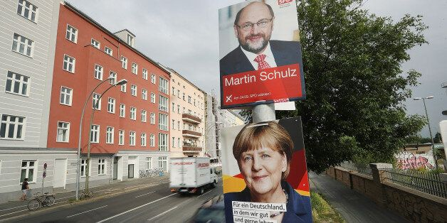 BERLIN, GERMANY - AUGUST 24: Cars drive past election campaign posters that depict German Social Democrat...