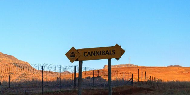 Cannibals road sign on the road to Drakensberg mountains, South