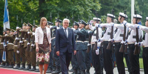 German President Frank-Walter Steinmeier (R) and his Estonian counterpart Kersti Kaljulaid review an...