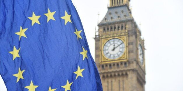 Anti Brexit demonstrators are seen waving European Union flags against the backdrop of the Big Ben, London...