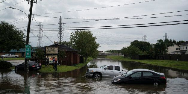 HOUSTON, TX - AUGUST 27: Vehicles are seen abandoned in flood water along Beamer Road in Houston, TX...