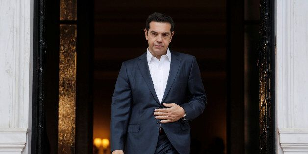 Greek Prime Minister Alexis Tsipras waits to welcome his Turkish counterpart Binali Yildirim at the Maximos...