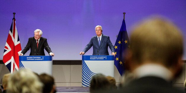 David Davis, U.K. exiting the European Union (EU) secretary, left, speaks as Michel Barnier, chief negotiator...