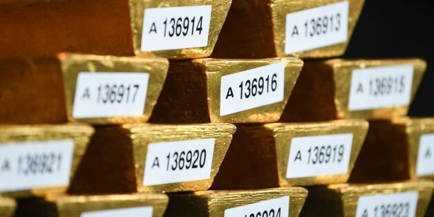 Gold bars are presented at the German Central Bank in Frankfurt am Main, central Germany on August 23,...