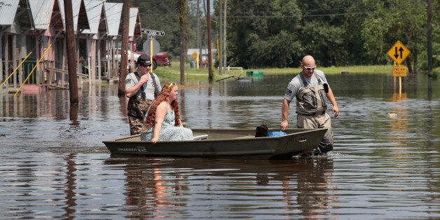 ORANGE, TX - SEPTEMBER 02: Members of the Wounded Veterans of Oklahoma help to rescue flood victims after...