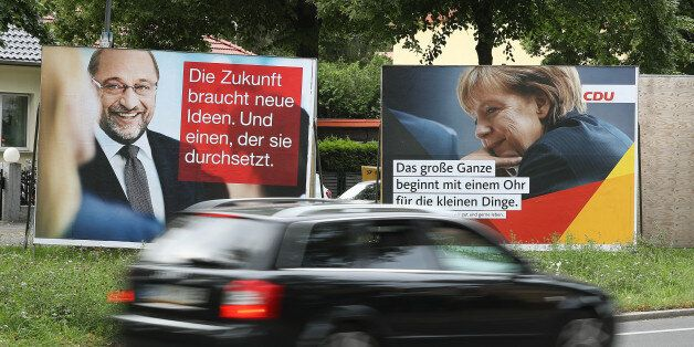 BERLIN, GERMANY - AUGUST 24: A car drives past election campaign billboards that depict German Social...