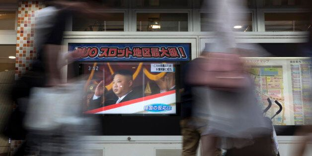 TOKYO, JAPAN - SEPTEMBER 03: Pedestrians walk past a monitor showing an image of North Korean leader...