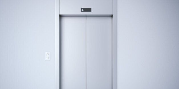 Modern elevator with closed metal doors. 3d