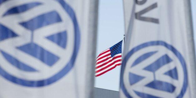 FILE PHOTO - An American flag flies next to a Volkswagen car dealership in San Diego, California, U.S....