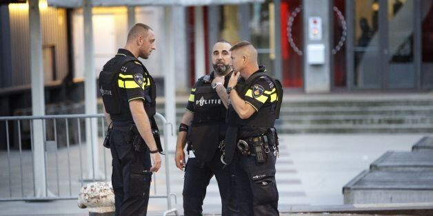 Police stand during the evacuation the Maassilo concert venue after a concert by Californian ban Allah-Las...