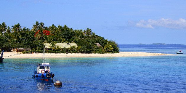 Ship anchored and Tropical paradise island: Dreamlike Sand deserted turquoise beach, Idyllic Yasawas, Fiji Islands