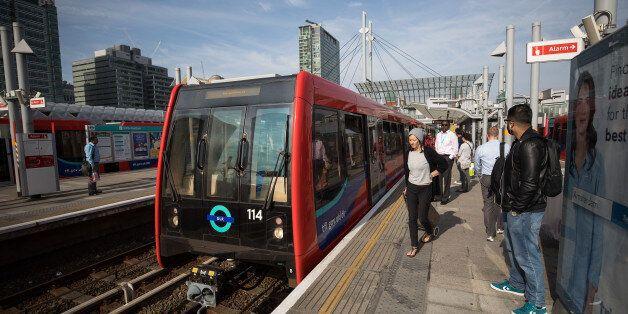 A Docklands Light Railway (DLR) arrives at Poplar station in London, U.K., on Monday, Aug. 14, 2017....