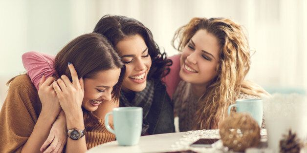 Three happy women enjoying at home and embracing.