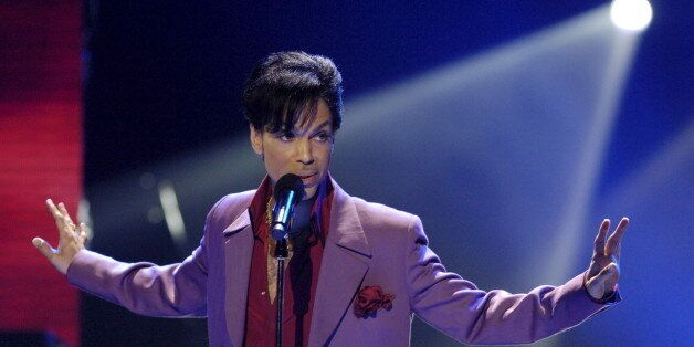 Singer Prince performs in a surprise appearance on the