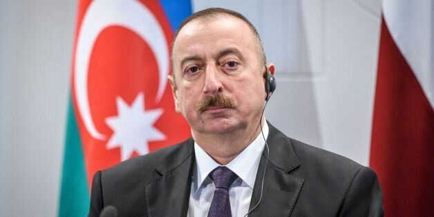 Azeri President Ilham Aliyev attends a press conference after a meeting with Latvian counterpart at the...