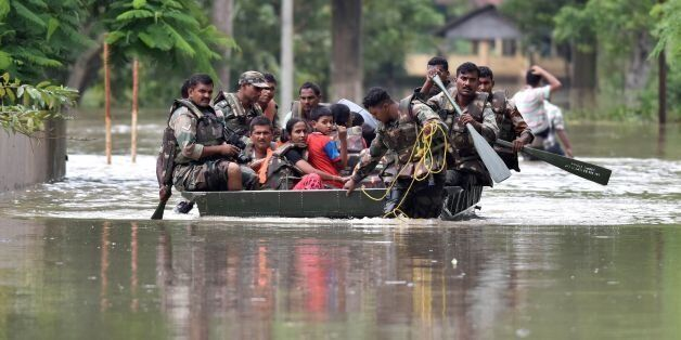 Indian army soldiers evacuate villagers in the flood affected Jakhalabandha area in Koliabor, some 186km...