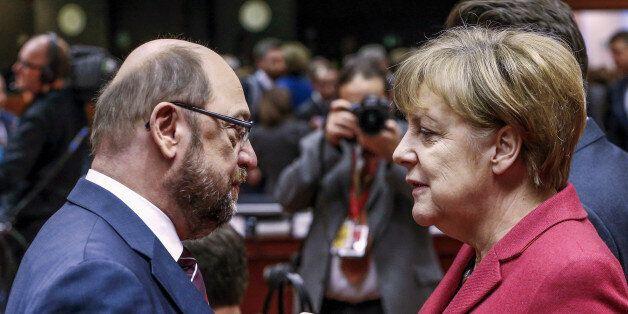 European Parliament President Martin Schulz (L) and German Chancellor Angela Merkel attend a European...