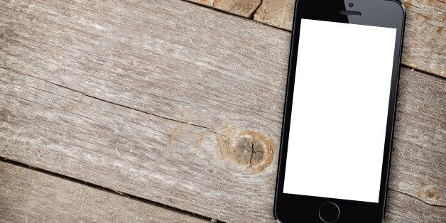 Smart phone on wooden table background with copy